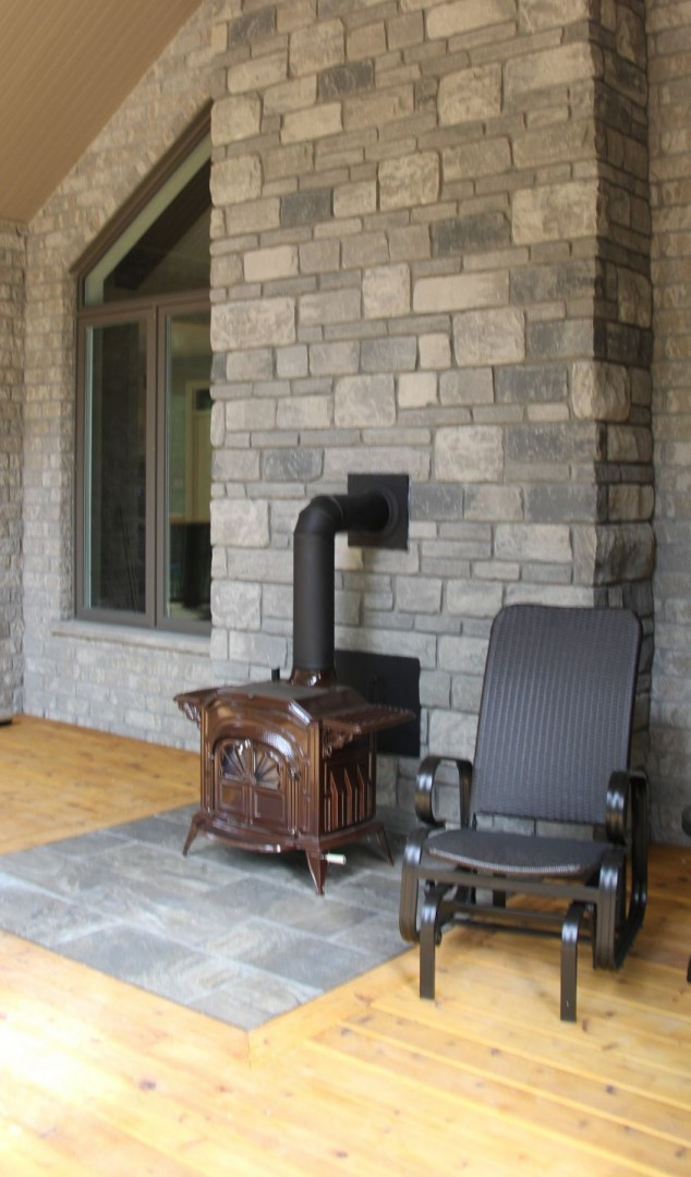 huron-woods-home-2015_rear_deck_outdoor_fireplace_off_of_master_bedroom